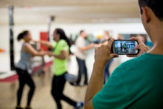 Student recording an instructor dancing