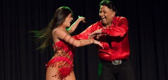 Eddie Torres dancing with woman