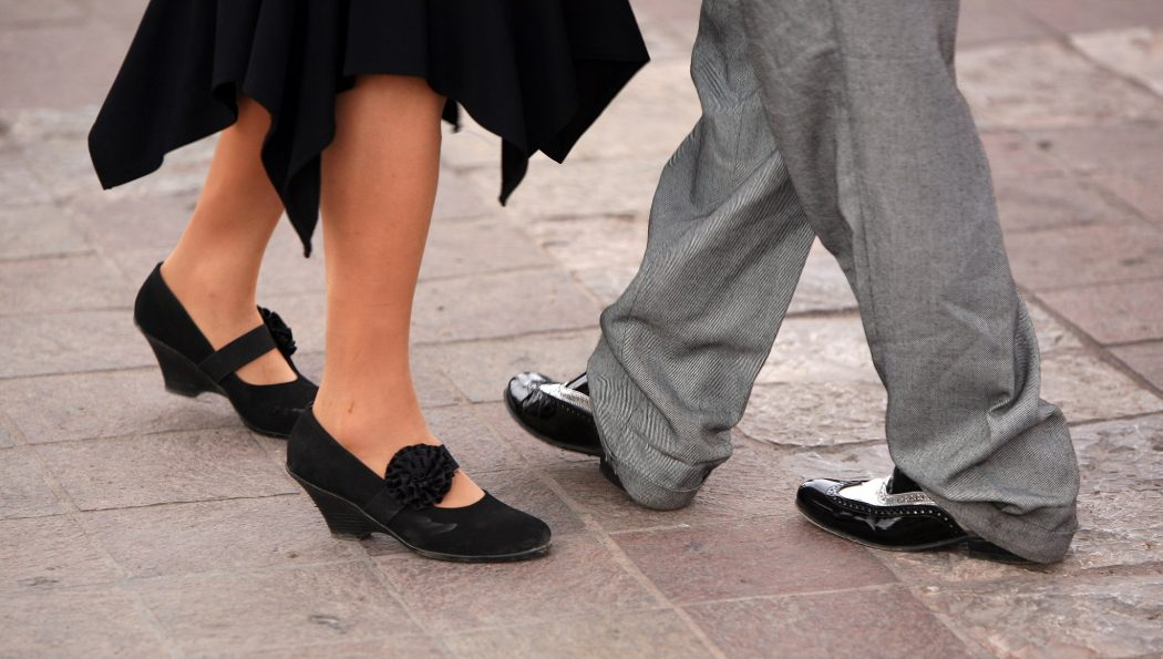 The feet of two partner dancers