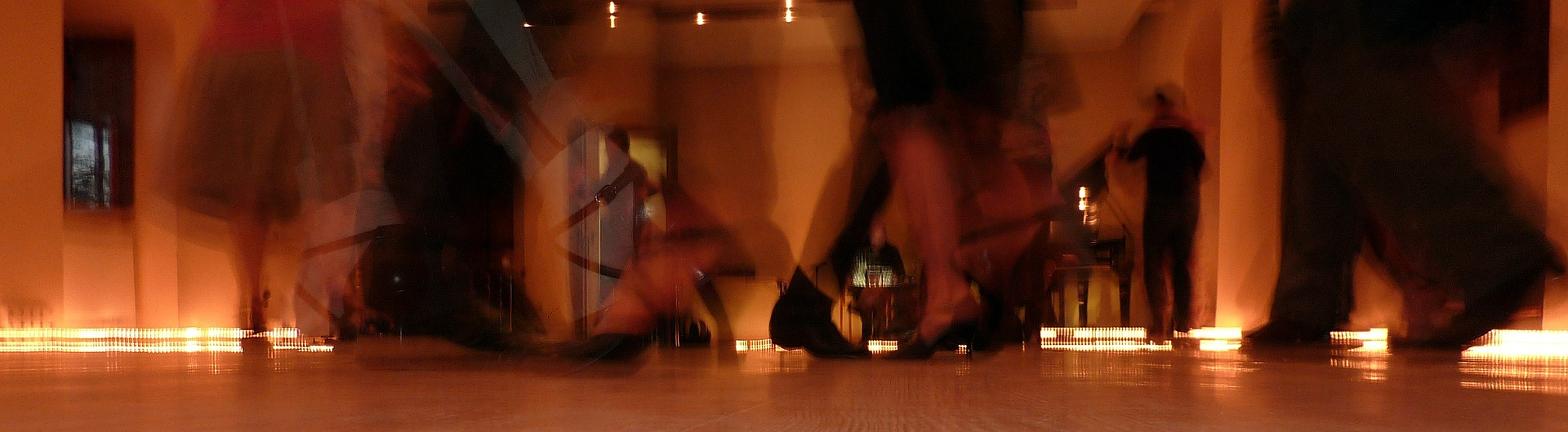 Blurred feet of dancers at a milonga